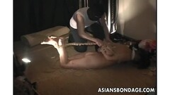 Beautiful asian tied up and caned Thumb